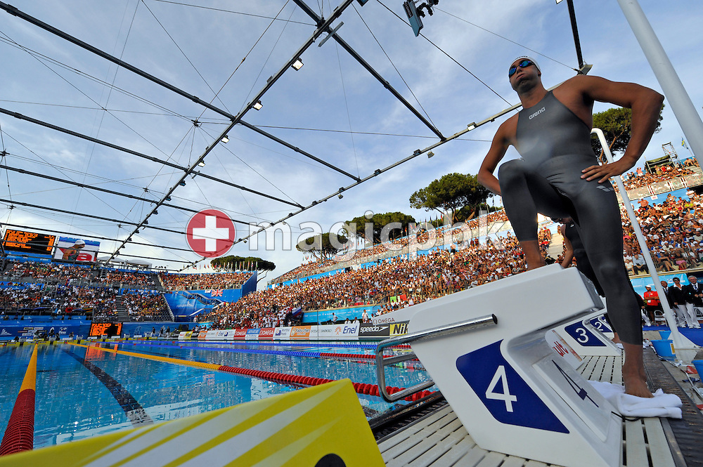 World record setter Milorad Cavic of Serbia steps on the starting block before competing in the men's 100m butterfly semifinal at the 13th FINA World Championships at the Foro Italico complex in Rome, Italy, Friday, July 31, 2009. (Photo by Patrick B. Kraemer / MAGICPBK)