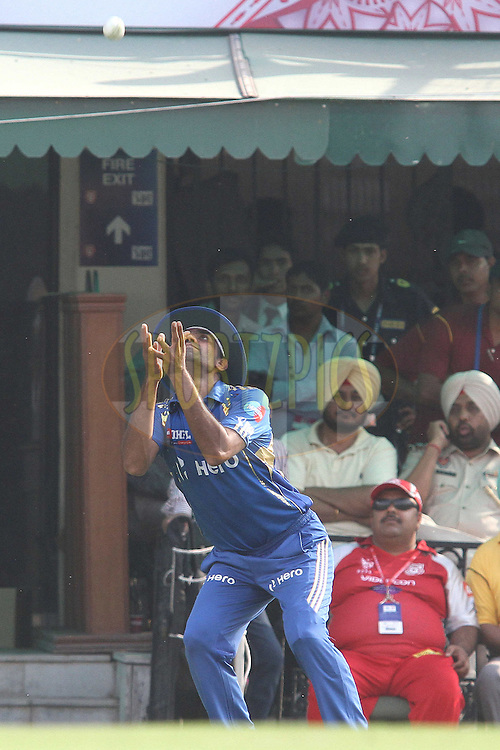 Munaf Patel of the Mumbai Indians gets under the ball to take the catch to dismiss Nitin Saini of the Kings XI Punjab during match 33 of the the Indian Premier League (IPL) 2012  between The Kings X1 Punjab and The Mumbai Indians held at the Punjab Cricket Association Stadium, Mohali on the 25th April 2012..Photo by Shaun Roy/IPL/SPORTZPICS