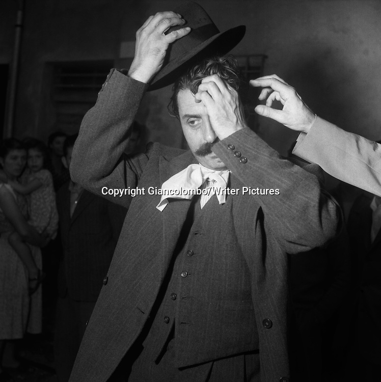 Giovannino Guareschi on the set of the movie The Little World of Don Camillo, made out of his novel. Brescello, (Parma) <br /> 1951<br /> <br /> Photograph by Giancolombo/Writer Pictures<br /> <br /> WORLD RIGHTS, NO AGENCY, NO ITALY