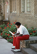 PALO ALTO, CA - OCTOBER 4:  Dennis Green, Stanford University Offensive Coordinator, studies game notes prior to a Stanford football game against San Jose State on October 4, 1980 outside the Stanford locker room near Stanford Stadium in Palo Alto, California.  (Photo by David Madison/Getty Images)