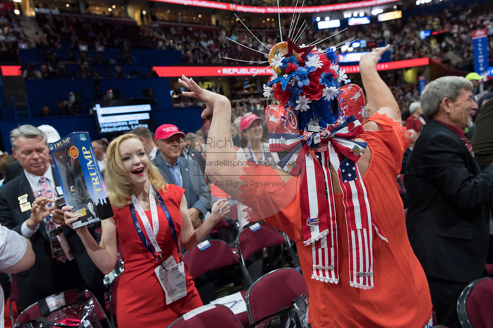 GOP Florida delegates dance in the aisles during the Republican National Convention July 20, 2016 in Cleveland, Ohio.