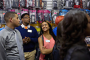 Isaiah Polk, second from left, Perri Cleveland, center, and other participants in Ohio University's Junior Executive Business Program listen to a presentation by Aaron Thomas, owner of Class A Sounds, at the store on July 14, 2014. Photo by Lauren Pond