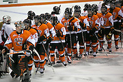 RIT and Pursuit of Excellence players shake hands after an exhibition game at RIT's Gene Polisseni Center on Monday, September 29, 2014.