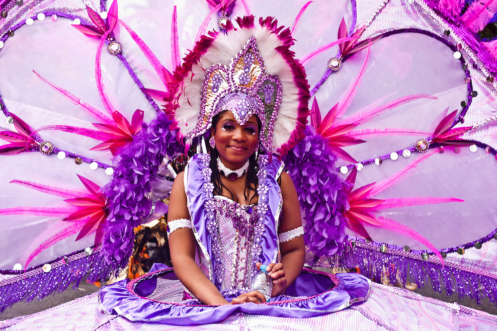 London, UK - 27 August 2012: a girl in her costume poses during the parade of the annual Notting Hill Carnival.
