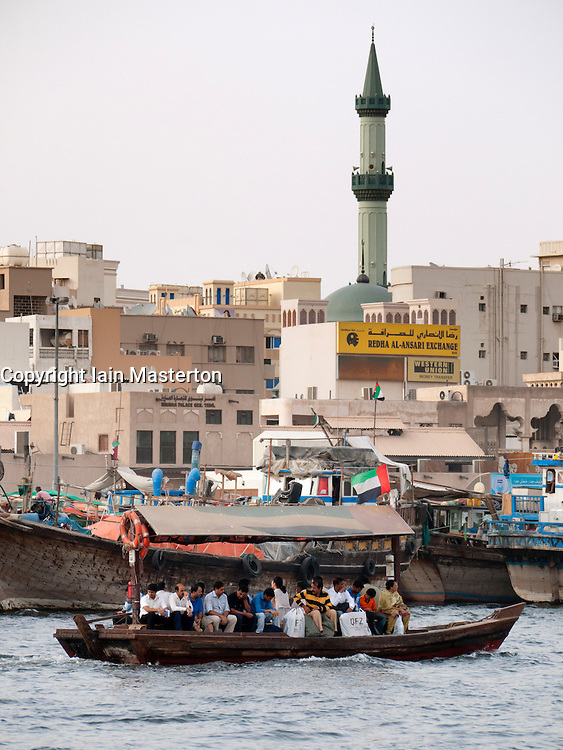 Traditional Abra water taxi crossing The Creek river in Deira Dubai United Arab Emirates UAE