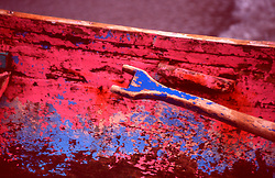 Colorful detail of wooden boat and oar in the Caribbean.