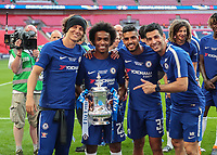 Football - 2018 FA Cup Final - Chelsea vs. Manchester United<br /> <br /> David Luiz (Chelsea FC), Willian (Chelsea FC) Emerson (Chelsea FC) pose with the trophy at Wembley Stadium.<br /> <br /> COLORSPORT/DANIEL BEARHAM