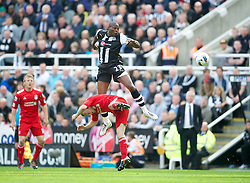 NEWCASTLE-UPON-TYNE, ENGLAND - Sunday, April 1, 2012: Liverpool's Jay Spearing in action against Newcastle United's Shola Ameobi during the Premiership match at St James' Park. (Pic by David Rawcliffe/Propaganda)