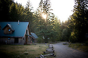 Sun sets over the main house at the Opal Creek Campground in Oregon