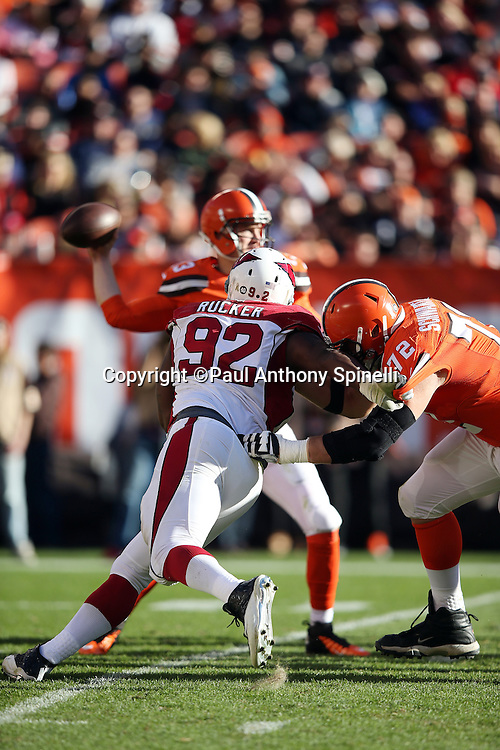 Arizona Cardinals defensive end Frostee Rucker (92) gets blocked by Cleveland Browns tackle Mitchell Schwartz (72) as he rushes Cleveland Browns quarterback Josh McCown (13) during the 2015 week 8 regular season NFL football game against the Cleveland Browns on Sunday, Nov. 1, 2015 in Cleveland. The Cardinals won the game 34-20. (©Paul Anthony Spinelli)