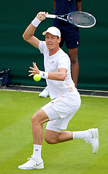 LONDON, ENGLAND - Monday, June 23, 2014: Victor Hanescu (ROU) serves during the Gentlemen's Singles 1st Round match on day one of the Wimbledon Lawn Tennis Championships at the All England Lawn Tennis and Croquet Club. (Pic by David Rawcliffe/Propaganda)