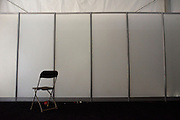 Philadelphia, Pennsylvania - September 17, 2015: A solitary office chair in the yet to be used production tent.<br /> <br /> Scott Mirkin's company ESM is heading the production of The World Meeting Of Families and Pope Francis's visit to Philadelphia this Fall. The events will take place along the Benjamin Franklin Parkway.<br /> <br /> CREDIT: Matt Roth for The New York Times<br /> Assignment ID: 30179397A