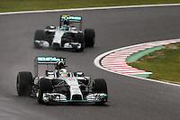 Lewis Hamilton (GBR) Mercedes AMG F1 W05 leads team mate Nico Rosberg (GER) Mercedes AMG F1 W05.<br /> Japanese Grand Prix, Sunday 5th October 2014. Suzuka, Japan.