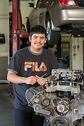 Sam Houston High School student Johnny Pineda poses for a photograph in an auto mechanics class at the Barbara Jordan High School for Careers, November 21, 2016.