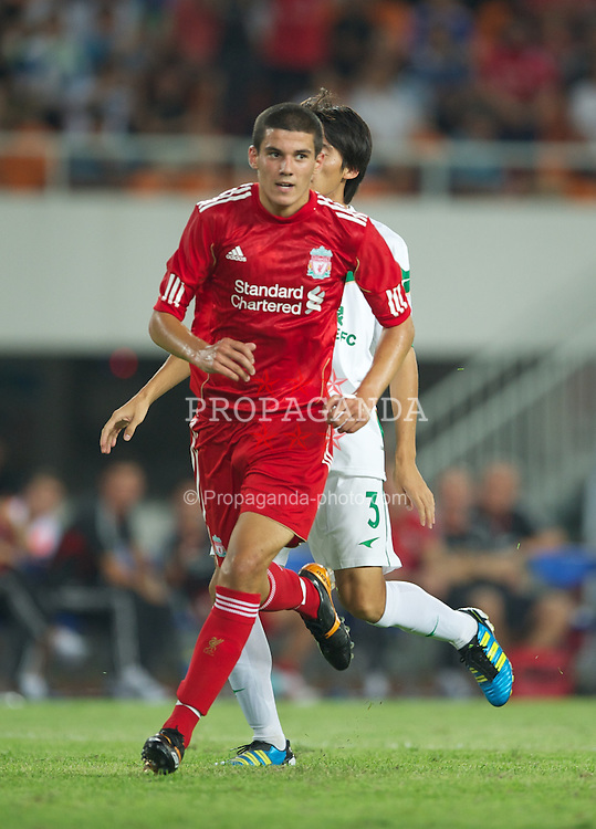 GUANGZHOU, CHINA - Wednesday, July 13, 2011: Liverpool's Conor Coady celebrates scoring a goal on his first team debut against Guangdong Sunray Cave during the first pre-season friendly on day three of the club's Asia Tour at the Tianhe Stadium. (Photo by David Rawcliffe/Propaganda)