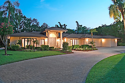 Florida house with circular driveway at night Front home exterior