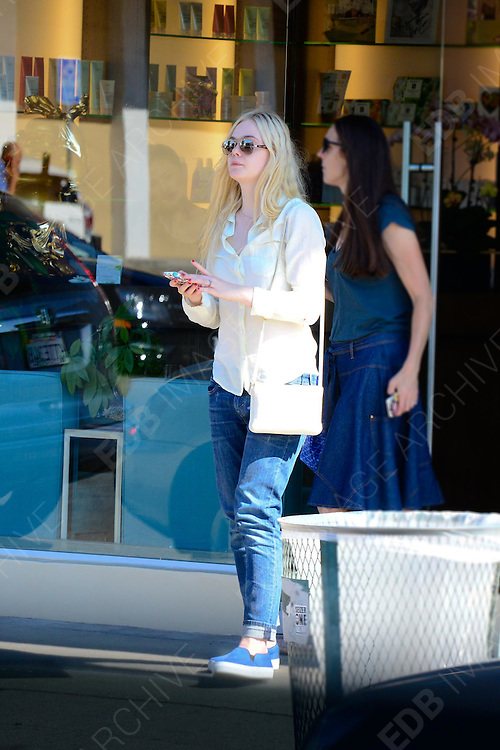 14.AUGUST.2013. LOS ANGELES<br /> <br /> EXCLUSIVE***<br /> ELLE FANNING LEAVING THE NAILS SALON WITH FRESHLY PAINTED RED NAILS IN HOLLYWOOD, L.A.<br /> <br /> BYLINE: EDBIMAGEARCHIVE.CO.UK<br /> <br /> *THIS IMAGE IS STRICTLY FOR UK NEWSPAPERS AND MAGAZINES ONLY*<br /> *FOR WORLD WIDE SALES AND WEB USE PLEASE CONTACT EDBIMAGEARCHIVE - 0208 954 5968*