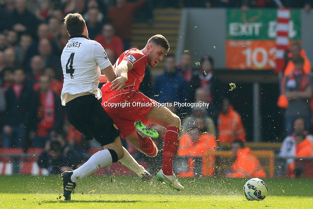 22nd March 2015 - Barclays Premier League - Liverpool v Manchester United - Phil Jones of Man Utd fouls Jordan Henderson of Liverpool - Photo: Simon Stacpoole / Offside.