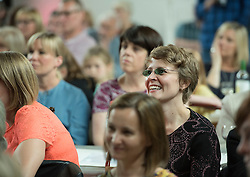 Pictured: Co-organiser Kyrsta Macdonald-Scott enjoying the show<br /> <br /> The community in Portobello came out last night in support of a locally organised campaign to try and save a local church and its attached church hall for the community. No longer needed by the church, who plan to sell it, the hall is widely used by community groups. The campaign hopes to make use of Scottish community buy-out legislation that has recently been extended to cover urban areas in one fo the first such campaigns in a Scottish urban area. Local film acting couple, Shauna Macdonald and Cal MacAninch, were instrumental in the event that featured a variety of local talent and was attended by about 150 people, packing out the church hall. Shauna brought the show together, along with her sister Kyrsta, and Cal performed on stage in both the specially written short play that opened the evening and singing with the band Hooseband at the show's finale.  <br /> <br /> <br /> <br /> © Jon Davey/ EEm