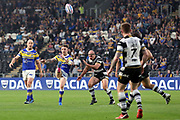 A Leeds Rhinos player puts a kick in during the Betfred Super League match between Hull FC and Leeds Rhinos at Kingston Communications Stadium, Hull, United Kingdom on 19 April 2018. Picture by Mick Atkins.