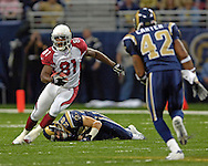 Arizona wide receiver Anquan Boldin (81) brakes past St. Louis safety Mike Furrey (25), as Rams Jerome Carter (42) closes in for a tackle at the Edward Jones Dome in St. Louis, Missouri, November 20, 2005.  The Cardinals beat the Rams 38-28.
