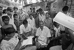BANGLADESH TONGI ERSHAD COLONY 13OCT00 - The Ershad camp chairman (C, seated) listens to our appeal for information about the possible whereabouts of Lisa's biological parents. In the past, several Dutch-Bangladeshi children (now adults) have visited the Ershad colony and by a freak accident, found their biological parents. In one case, the girl in question, Rashida, recognised the immediate surroundings of her old home and simply walked home into the arms of her mother!..jre/Photo by Jiri Rezac..© Jiri Rezac 2000..Tel/Fax: +44 (0) 20 8968 9635.Mobile: +44 (0) 7801 337 683..Email: jiri@jirirezac.com.Web: www.jirirezac.com..All pictures © Jiri Rezac 2000. All rights reserved.