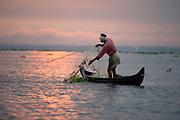 Mussel fisherman on Lake Vembanad, Kerala Backwaters, India.
