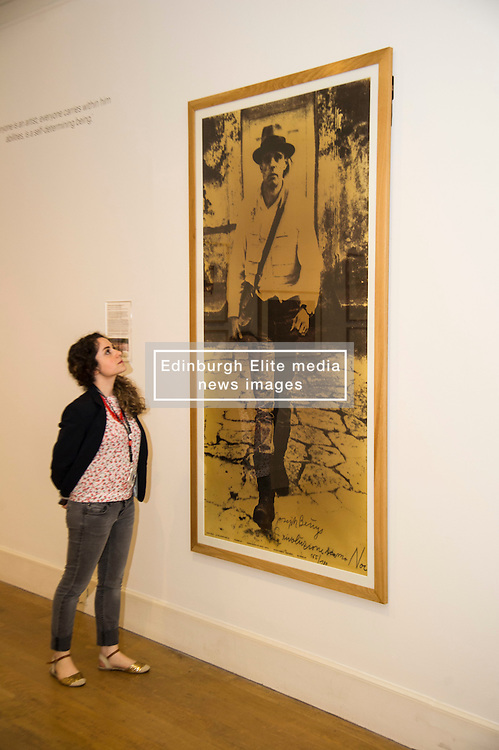 Pictured: Adalie Amar looks up to the portrait of Joseph Beuys. <br /> The Richard Demarco & Joseph Beuys A Unique Partnership exhibition examines the collaboration between the avant-garde gallerist and German post-war artist. The exhibition is open to the public between  30 July and 1 October 2016<br /> <br /> Ger Harley | EEm 28 July 2016