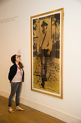 Pictured: Adalie Amar looks up to the portrait of Joseph Beuys. <br /> The Richard Demarco &amp; Joseph Beuys A Unique Partnership exhibition examines the collaboration between the avant-garde gallerist and German post-war artist. The exhibition is open to the public between  30 July and 1 October 2016<br /> <br /> Ger Harley | EEm 28 July 2016