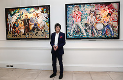 Ronnie Wood with his two new paintings  Electric Horses (left)  and What Price Tickets (right) at the opening of a new exhibition of his work at the Castle Fine Art  gallery in Mayfair, London, Thursday, 11th April 2013 Photo by: Stephen Lock / i-Images