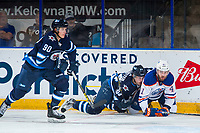 PENTICTON, CANADA - SEPTEMBER 9: Evan Polei #41 of Edmonton Oilers is checks Michael Webster #94 of the Winnipeg Jets to the ice during first period on September 9, 2017 at the South Okanagan Event Centre in Penticton, British Columbia, Canada.  (Photo by Marissa Baecker/Shoot the Breeze)  *** Local Caption ***