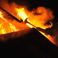 Firefighters battle a blaze on Burlington St in Lowell. The Sun photo by Tory Germann