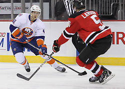 Mar 8; Newark, NJ, USA; New York Islanders left wing David Ullstrom (41) skates with the puck while being defended by New Jersey Devils defenseman Adam Larsson (5) during the first period at the Prudential Center.
