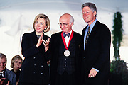 Professor Martin E. Marty is presented the National Humanities Medal by President Bill Clinton and First Lady Hillary Clinton during a ceremony on the South Lawn of the White House September 29, 1997 in Washington, DC.
