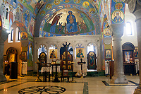 orthodox church interior in Tbilisi,Georgia:altar,crosses,columns and icons