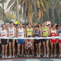 Runners warm up before the second annual Saint John's Santa Monica 5000 on Sunday