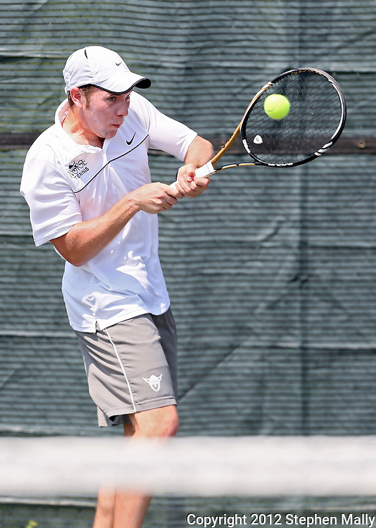 Luther's Scott Sundstrom returns the ball during his match against Coe's Noah Sprinkel in the Iowa Conference Men's Tennis Championships at Veterans Memorial Tennis Center in Cedar Rapids on Saturday afternoon, May 5, 2012. (Stephen Mally/Freelance)