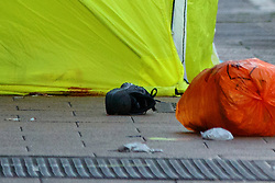 © Licensed to London News Pictures. 22/10/2016. London, UK. Belongings of a victim is seen as forensic officers investigate a crime scene after a man was found stabbed to death on Station Road in Wood Green, north London on Saturday, 22 October 2016. Photo credit: Tolga Akmen/LNP