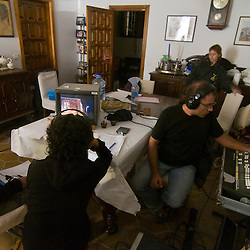 Director, assistant director and sound man control the action from inside the house.