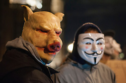 © Licensed to London News Pictures. 05/11/2016. London, UK. Participants wearing Guy Fawkes style masks take part in the Million Mask March in central London, amidst a heavy police presence. Photo credit : Stephen Chung/LNP
