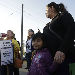 Immigrants rights supporters rally outside the US Immigration Customs Enforcement (ICE) Northwest Detention Center in Tacoma, Washington on March 11, 2014. Dozens of detainees on the fourth day of a hunger strike protesting U.S. deportations and detention center conditions at a Washington state immigration facility were being medically evaluated on Monday and could be force-fed, a federal agency said.  (Jason Redmond)