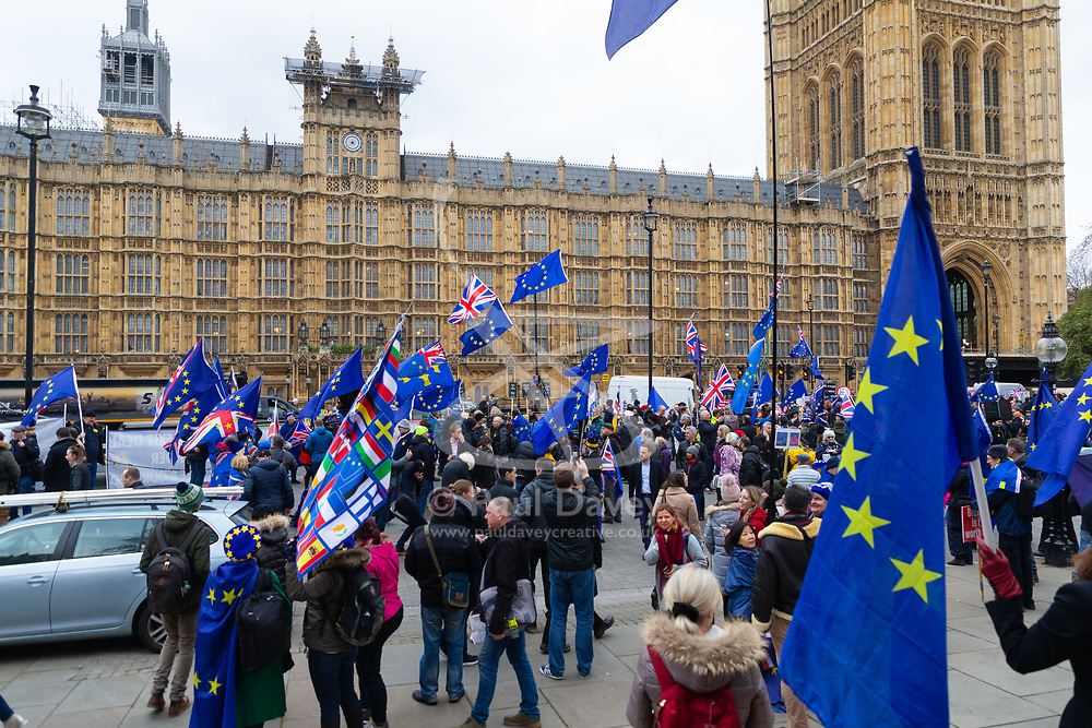 Leave and Remain demonstrators create a colourful display of flags and banners outside the House of Commons in London, where MPs are debating Prime Minister Theresa Mays' Brexit deal. London, January 15 2019.