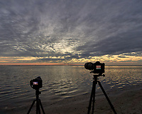 Cameras set up to photograph the sun rising under the Sunshine Skyway bridge from Fort De Soto Park in Pinellas County, Florida Image taken with a Leica T camera and 11-23 mm wide-angle zoom lens