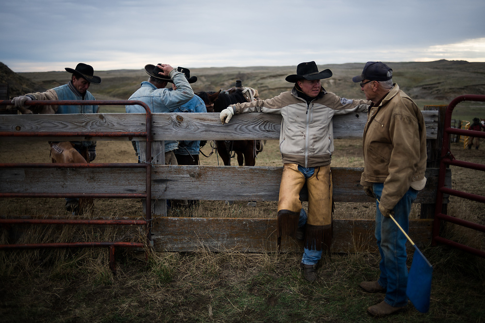 Cowboys take a break from sorting cattle on land owned by a grazing association west of Meadow, SD on October 8, 2017. Grazing associations provide a way for multiple ranchers to defray the costs of land owning and usage for grazing cattle and on occasion provide access to national grasslands and grazing areas.