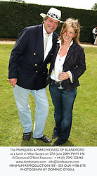 The MARQUESS & MARCHIONESS OF BLANDFORD at a lunch in West Sussex on 27th June 2004.PWM 146