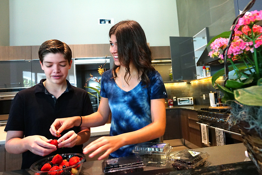 MAY 23, 2015---BOCA RATON, FLORIDA----<br /> Jordan Zietz, 13, and sister Rachel, 14 prepare a fruit salad in their Boca Raton house. The siblings are following in their father's entrepreneurial vein and have successful businesses.