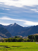 Looking north, a valley view of The Branches with Mount Greenland in the background, near Queenstown, Otago, New Zealand.