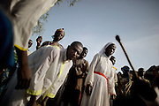 A nun and villagers are dancing during a funeral to honor a woman who died while giving birth to her babyboy. The child survived but the mother lost to much blood to be saved at the local hospital in the village of kabo.The central African rep. has some of the world's worst child welfare indicators. The infant mortality rate is 112, and out of 1,000 children born in CAR, 171 will die before reaching the age of five. The five main child killers in CAR are malaria, diarrhoea, acute respiratory infections, malnutrition and measles – all preventable diseases. The Accelerated Child Survival and Development Strategy UNICEF is implementing aims to reach every newborn and child in every district with a set of priority interventions. Evidence shows that there are a number of known and affordable interventions that if implemented fully could prevent 63 per cent of current childhood mortality.