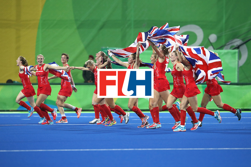 RIO DE JANEIRO, BRAZIL - AUGUST 19:  Great Britain players celebrating winning the shoot out against Netherlands to win the Women's Gold Medal Match on Day 14 of the Rio 2016 Olympic Games at the Olympic Hockey Centre on August 19, 2016 in Rio de Janeiro, Brazil.  (Photo by Mark Kolbe/Getty Images)