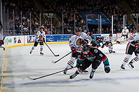 KELOWNA, BC - OCTOBER 20: Ilijah Colina #23 of the Portland Winterhawks shoots the puck into the boards as Marek Skvrne #9 of the Kelowna Rockets tries to block the pass during third period at Prospera Place on October 20, 2017 in Kelowna, Canada. (Photo by Marissa Baecker/Getty Images)
